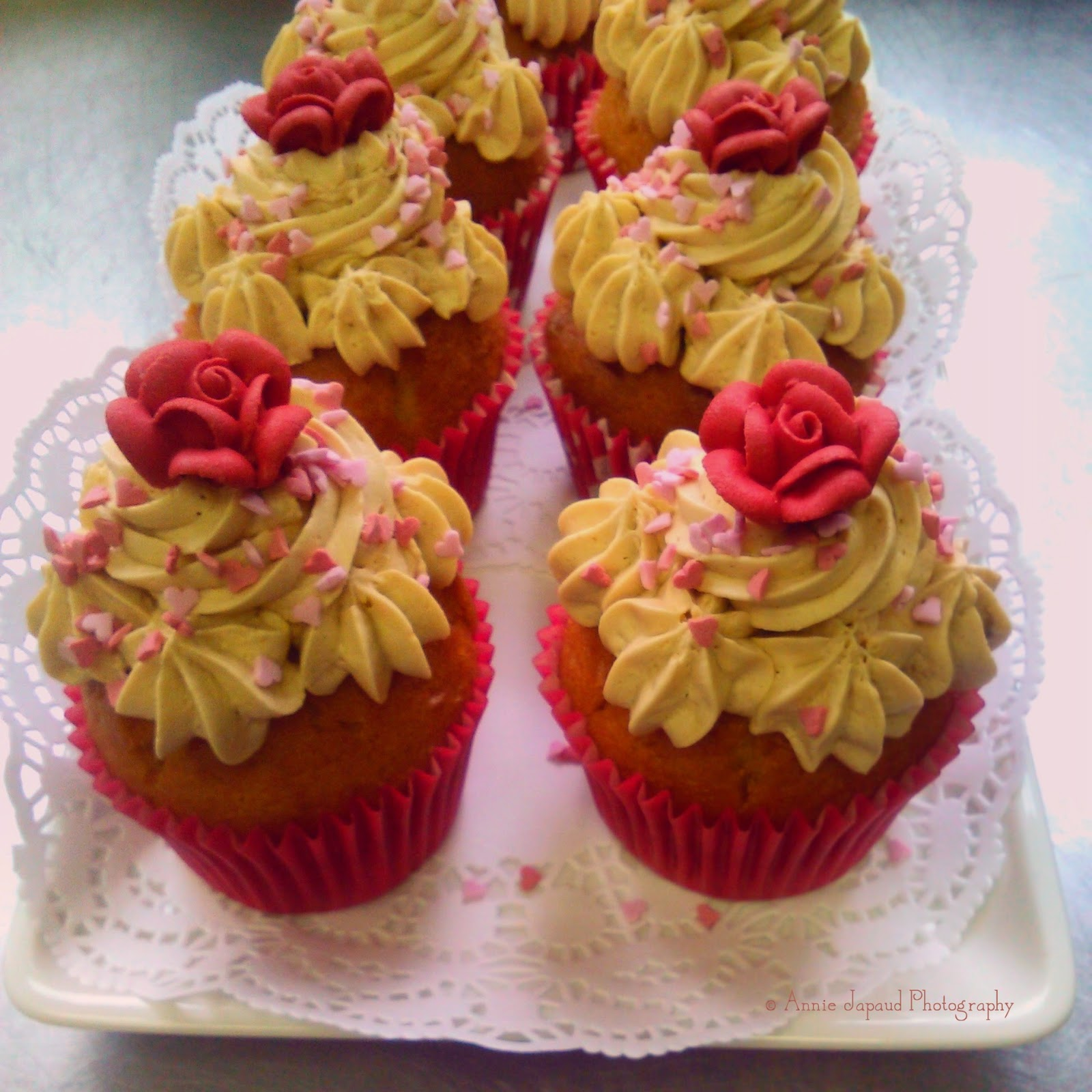 cupcakes with pink roses on top