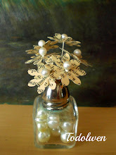 Little Flowers In Saltshaker Vase