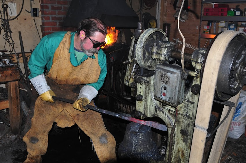 Shaping metal in the forge.