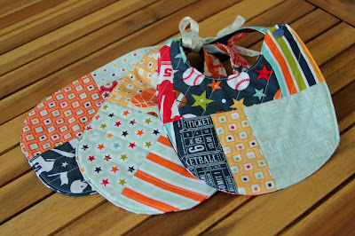 quilted baby bibs using sports fabric.