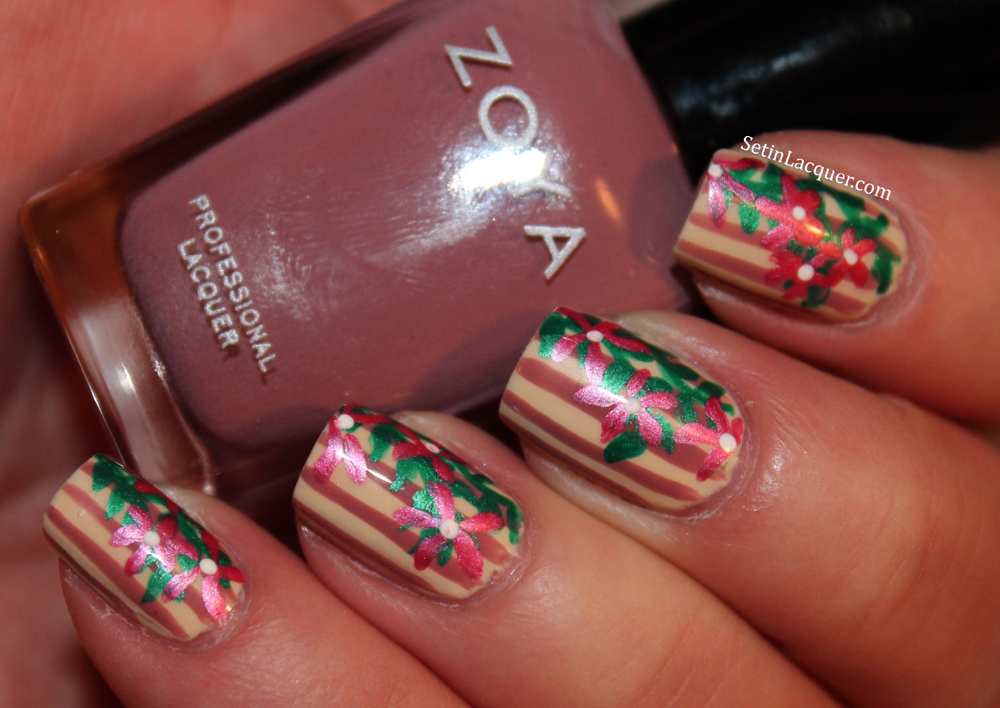 Floral nail art on striped background