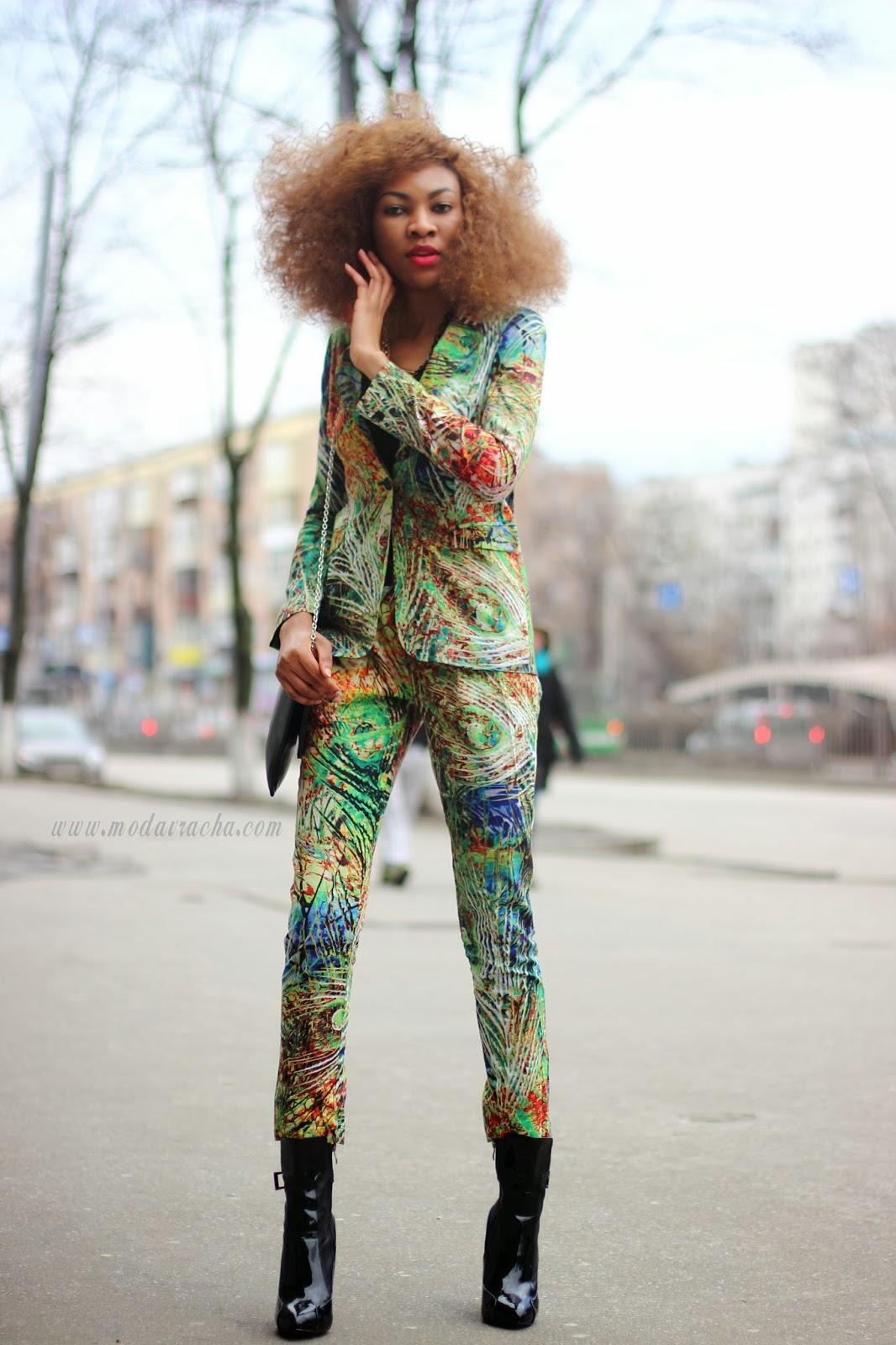 Nigerian fashion blogger modavracha in matchy matchy prints outfit and over the ankle boots.