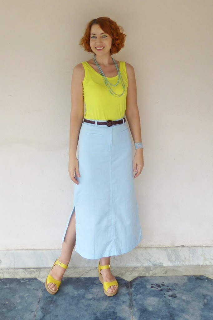 Yellow top worn with light blue skirt