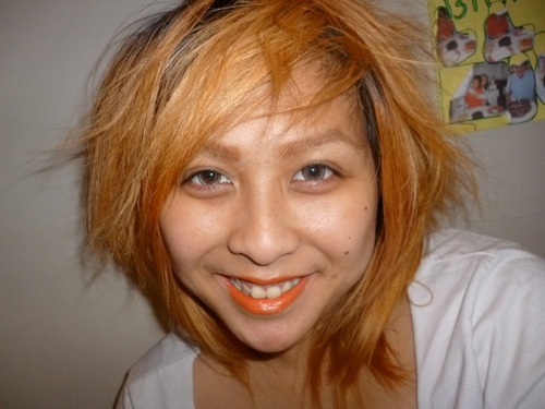 Orange lipstick, cheesy smile, orange hair, GEO Nudy Brown lenses