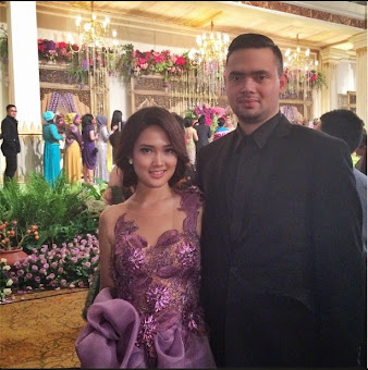 Fanny wearing purple lacey dress, one of our gown collections