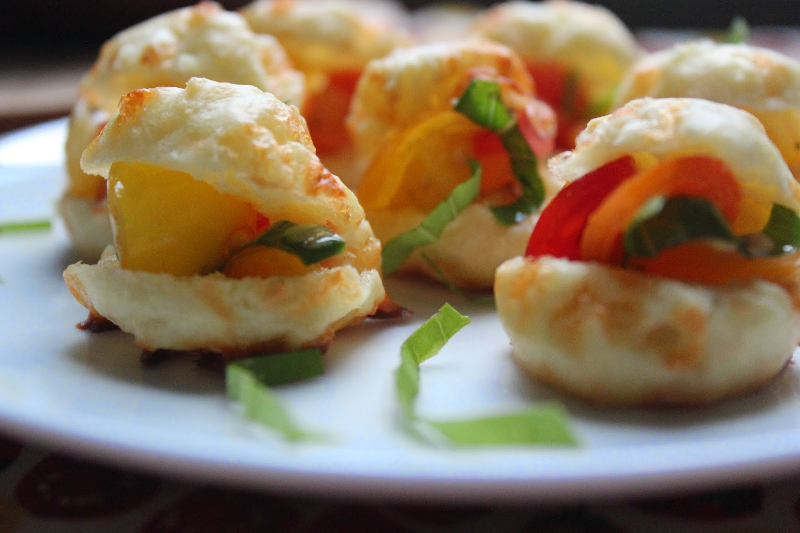 Mini profiteroles with tomatoes and basil