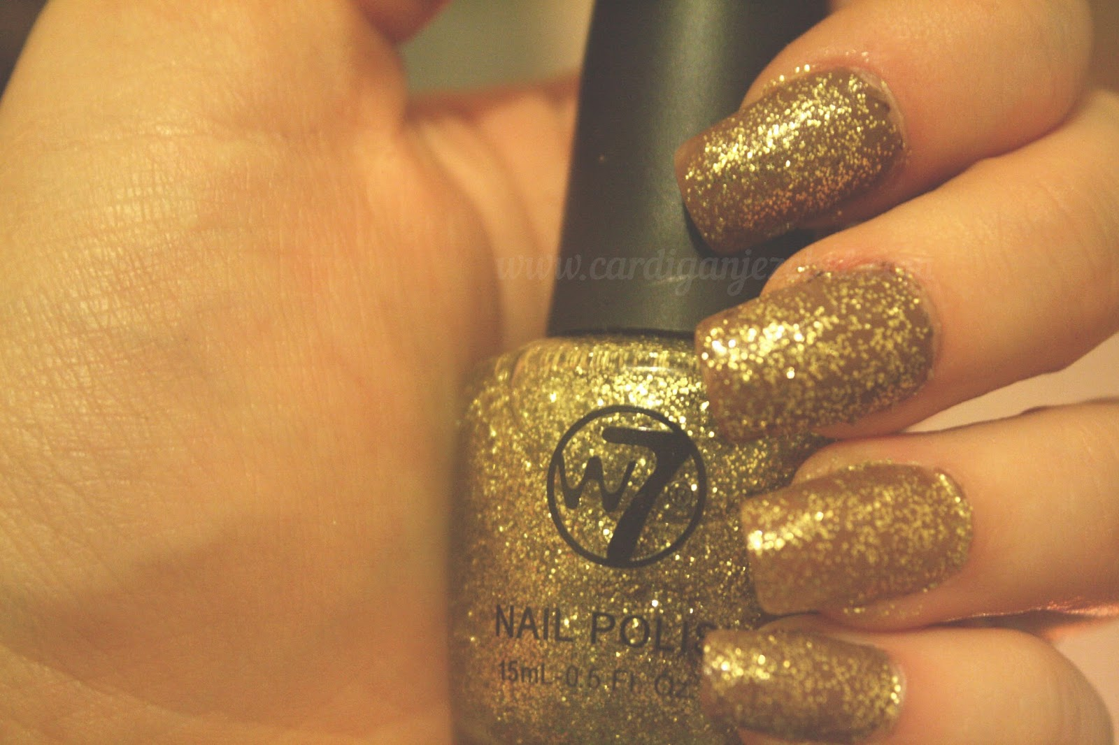 W7 gold glitter nail polish