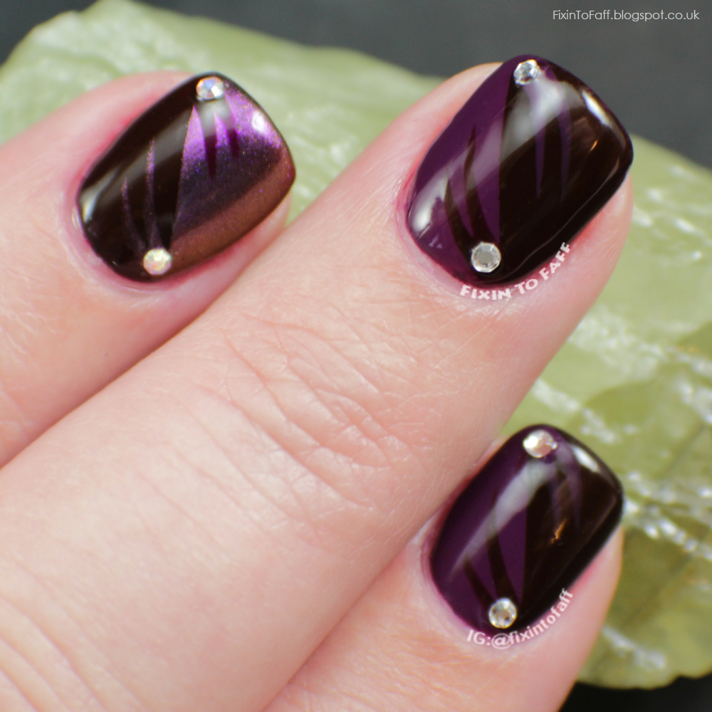 Half-and-half purple nail art.
