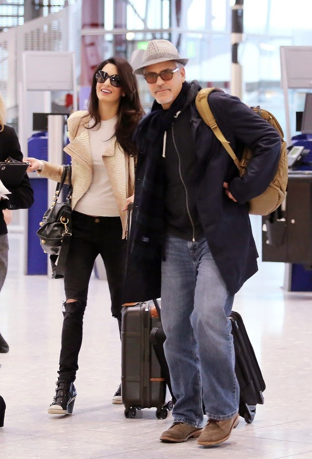 George Clooney travels with his wife, Amal Clooney