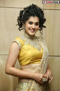 Actress Tapsee Pannu Pictures in Golden Saree at Elite Designer Fashion Show 0005