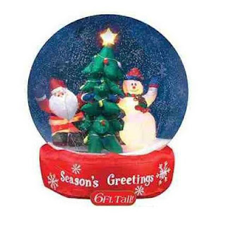 Christmas star,snowman, and Santa Claus with decorated X mas tree inside the snow globe photo with seasons greetings lettering image