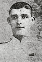 Grainy photo of short haired youngish man with pale uniform.  Caption is a link to page about him.