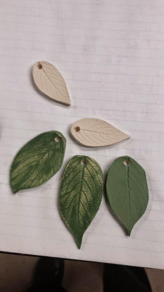Unique nature-inspired handmade ceramic pottery stoneware leaf pendants in progress.