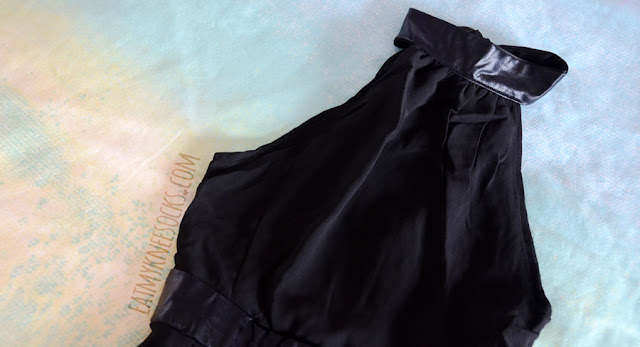 Close-up of the faux leather trim on the halter neckline of WalkTrendy's sheer side-split maxi dress/romper.