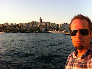The Galata Tower visible from the Galata Bridge at sunset.