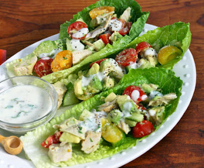 Picture of Recipe of chiken and avocado lettuce boats on white Plate
