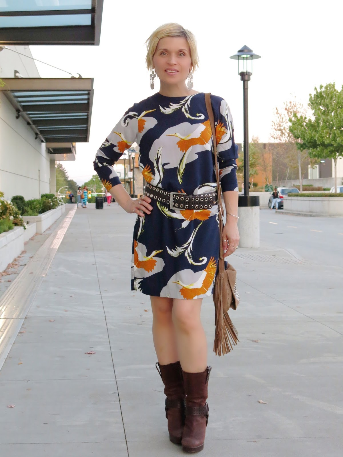styling a stork-print shift dress with a wide belt and Frye platform booties