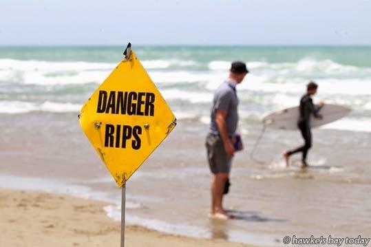 """Sign: """"Danger Rips"""" New Year's Day at Waimarama Beach, Waimarama, Hawke's Bay. photograph"""