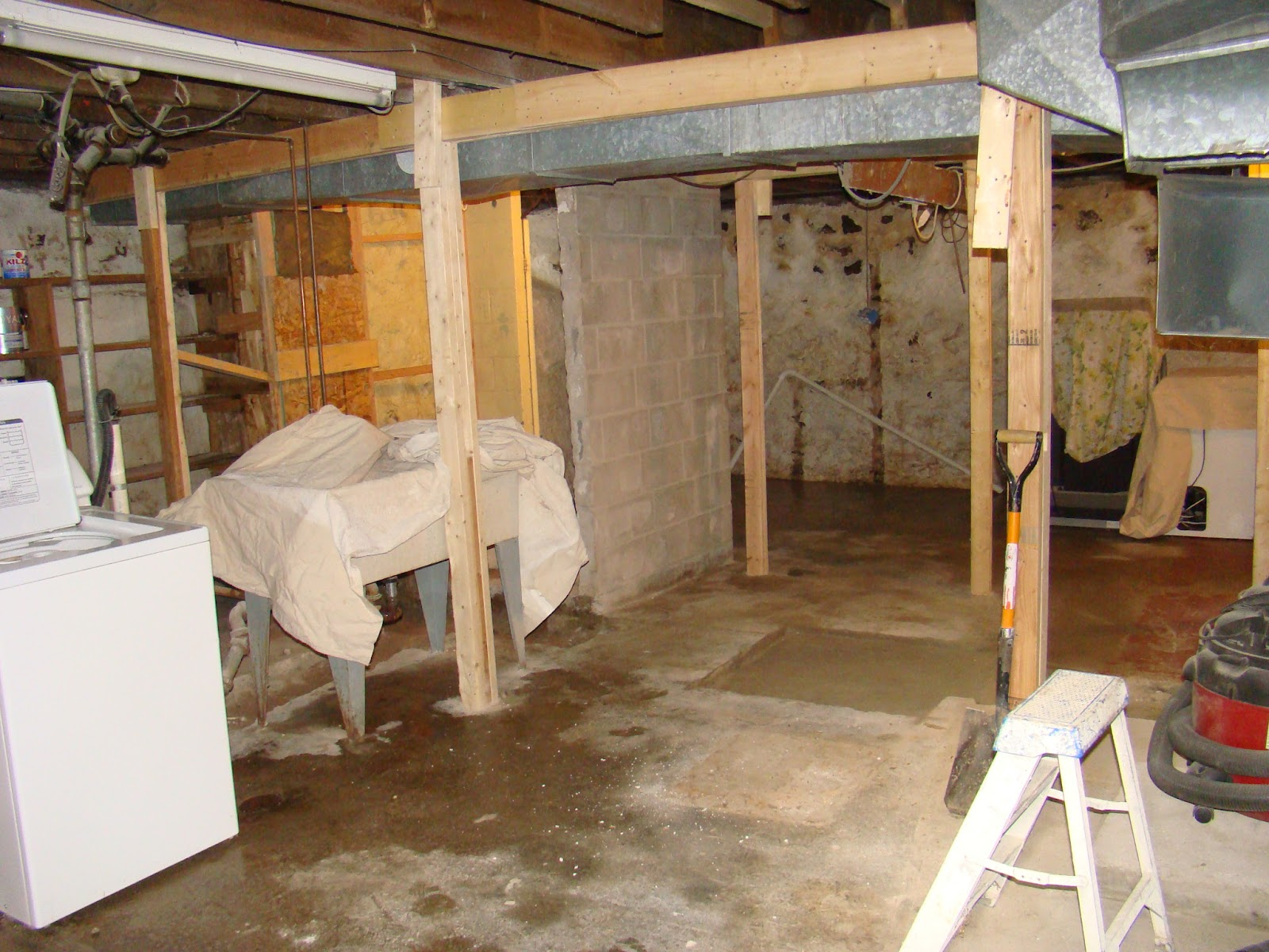 this old house field stone wall in basement gone