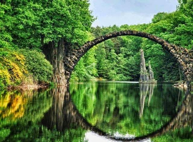 "Though it looks ancient, this bridge, which creates a stunning circular reflection, was actually built in the 1860s. Bridges like this are also known as ""Devil's Bridges,"" some of which date back to the Middle Ages. The ominous name comes from their narrow, scary-looking construction. This bridge is currently off-limits to climbers, but you can take all the photos you want."