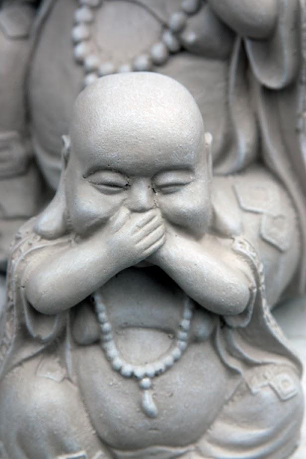 smiling grey buddhas