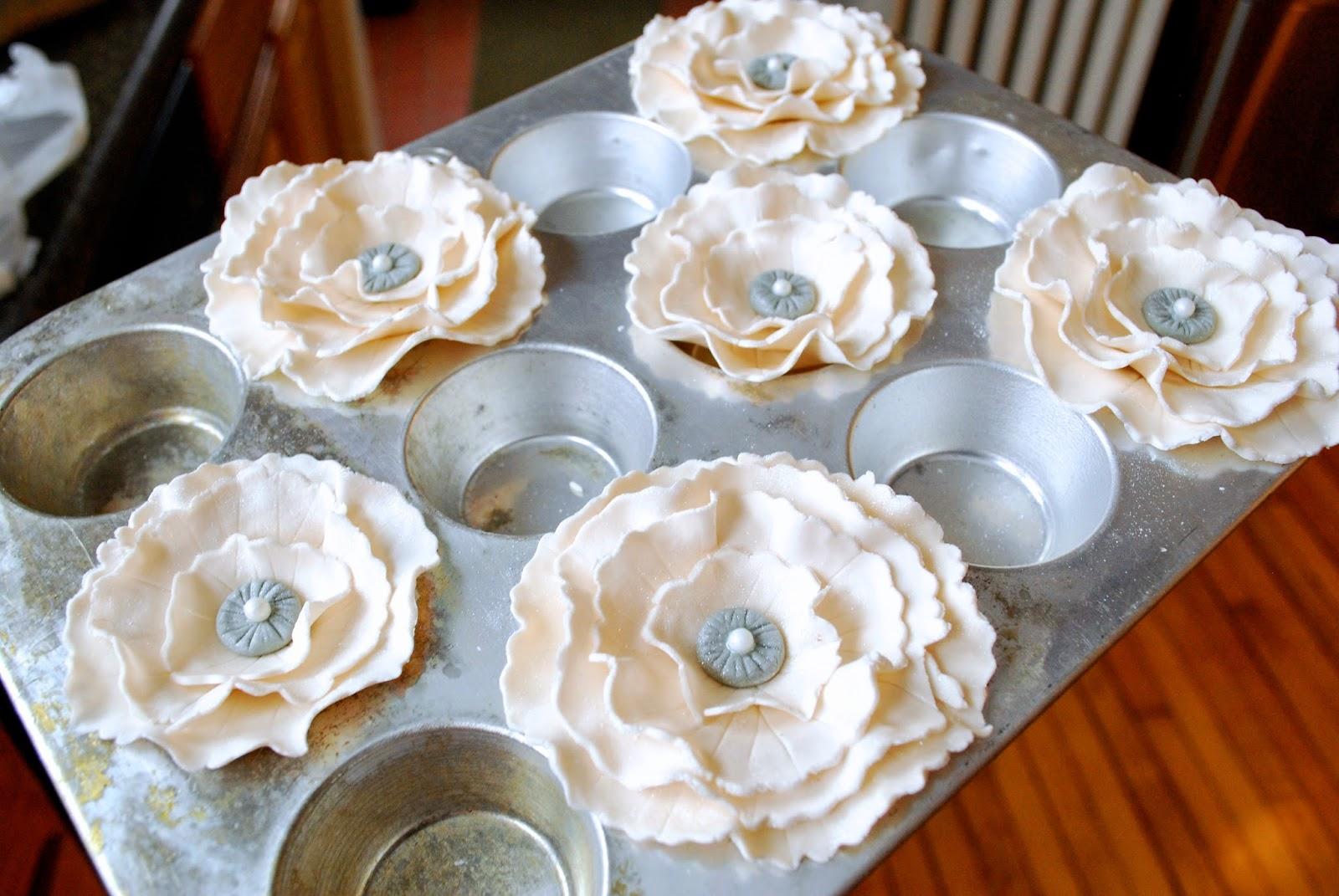 fondant flowers drying on muffin tin