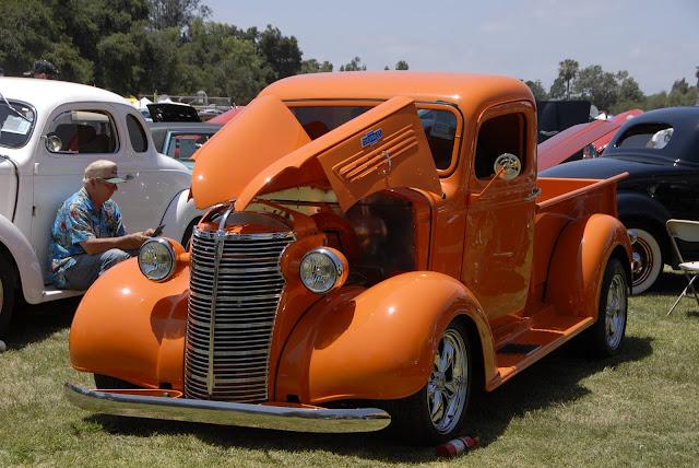 orange truck display at car show