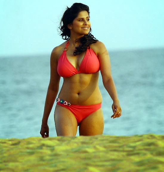Sai Tamhankar walking on the beach in Red Bikini