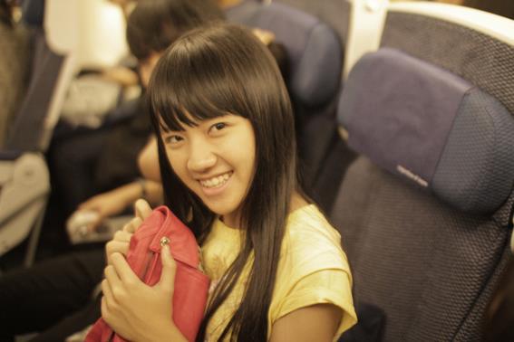Cindy JKT48 di dalam pesawat