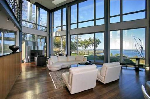 Modern Design Glass House in New York Livingroom 588x390 - Get Modern Small Glass House Design Pictures
