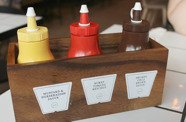 A picture of OAKS Restaurant Signature Table Sauces