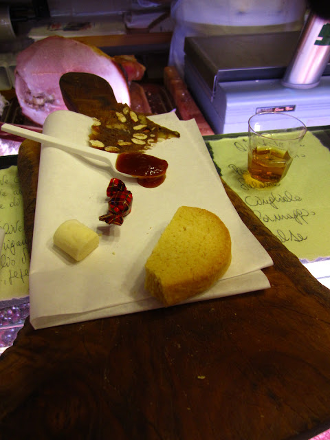 A photo of biscotti, brandy and apricot jam in Siena, Italy.