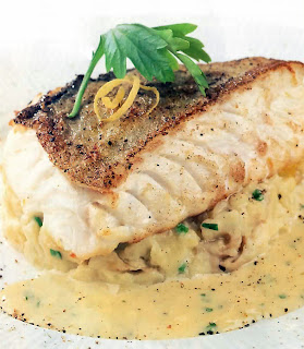 Crispy pan-fried cod served on a base of crushed potatoes with a lemon and parsley sauce