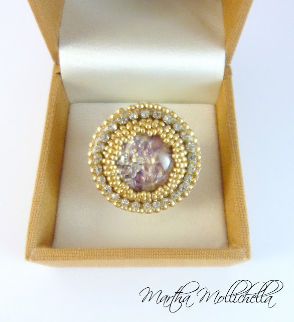 Handmade ring with glass cabochon and beads