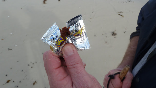opened spice sachet found on beach