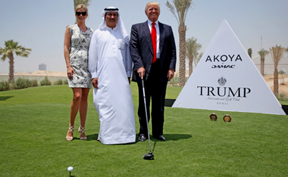 "Donald Trump standing next to Damac chairman Hussein Sajwani, one of the Muslims Trump would apparently ban from coming to the United States. Trump's name was snatched from the sign he's standing next to and the Trump ""branding"" was dumped from the $6 billion Damac golf project because of his Islamophobic pronouncements."