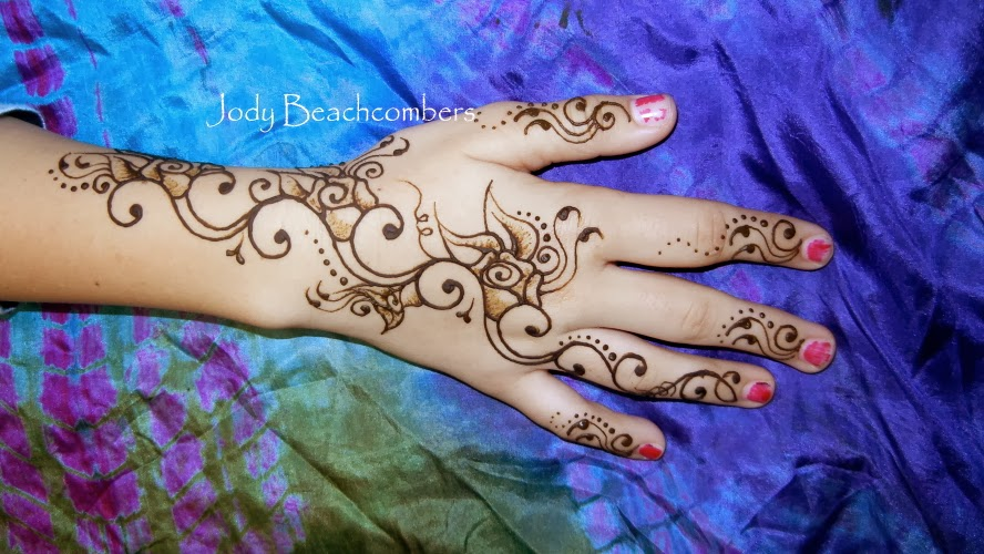 Lovely simple henna designs on the hand with rose flowers