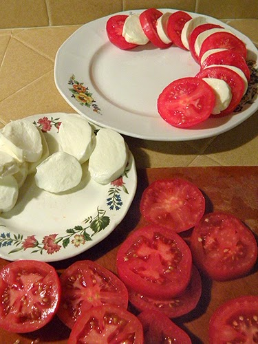 Slices of Mozzarella and Tomato being Arranged on Platter