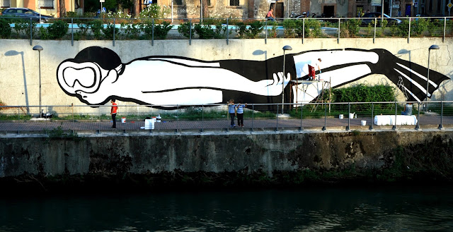 "Italian Street Artist MP5 Paints a new mural entitled ""Playing Upstream"" in Terni, Italy. 8"