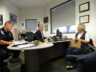 Chief Mendez (center) meets with Sgt. David Stovall and a staff member in his office.