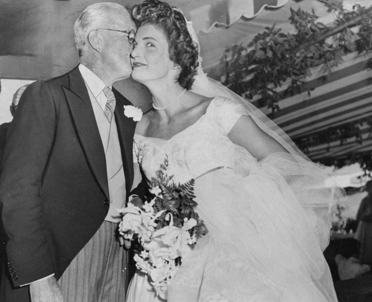 26 candid photographs from the wedding of john f kennedy and jacqueline bouvier kennedy gets a kiss from her father in law joseph kennedy after her wedding photo by pat candidony daily news archive via getty junglespirit Image collections