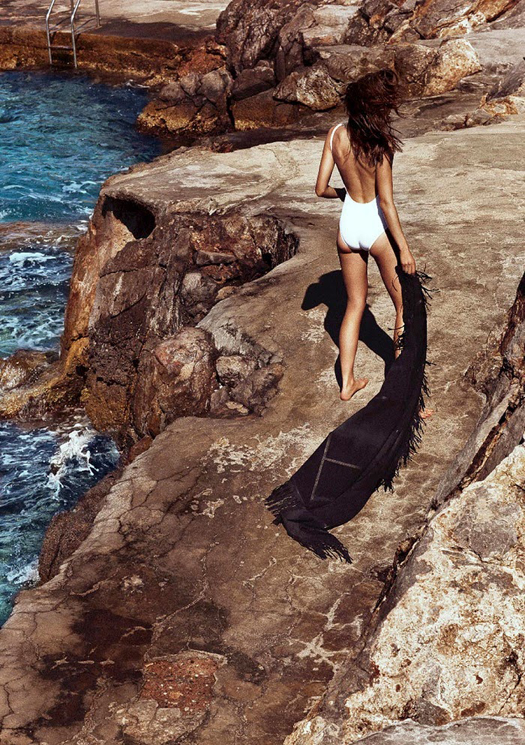 Beach inspiration, one-piece white swimsuit, oceanside cliffs, summertime