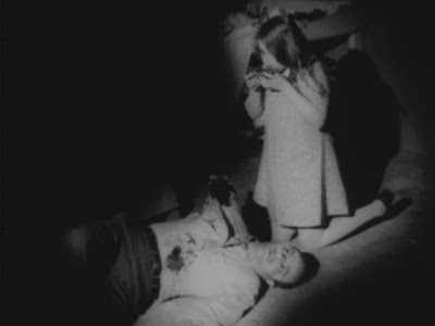 The girl zombie feasting on her father in Night of the Living Dead