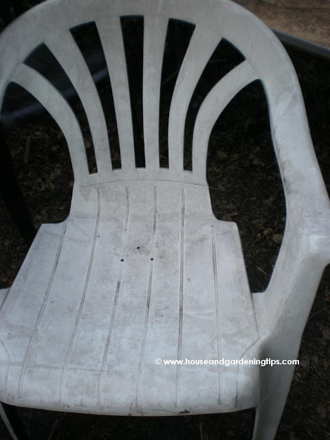 Dingy looking lawn or patio furniture can be easily reclaimed with a coat of paint. Note the 3 holes drilled in the bottom of the chair.  This allows the rain water to drain from the chair so you don't get a soggy butt after a rain storm.
