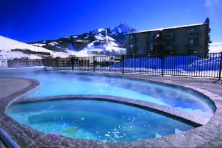 Outdoor Swimming Pool with Ski Slopes in background