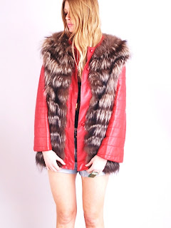 Vintage red leather jacket with brown fox fur attached gillet vest and button front closure.