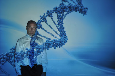 Dr. Todd Armstrong poses in a stand of DNA.