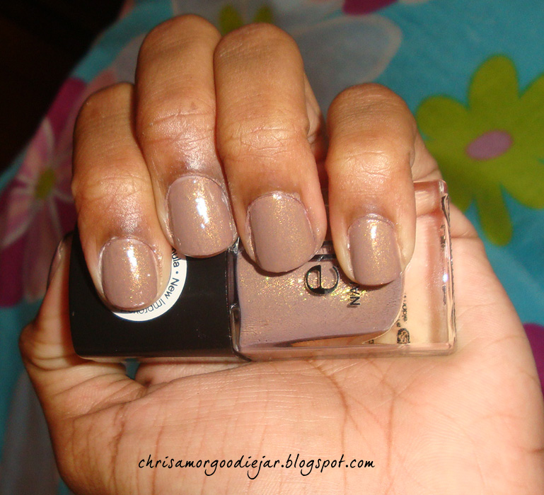 But since I missed yesterday's post, which I so gingerly painted my nails for, here it is. Swatches of this lovely nude polish from e.l.f. called Glamour ...