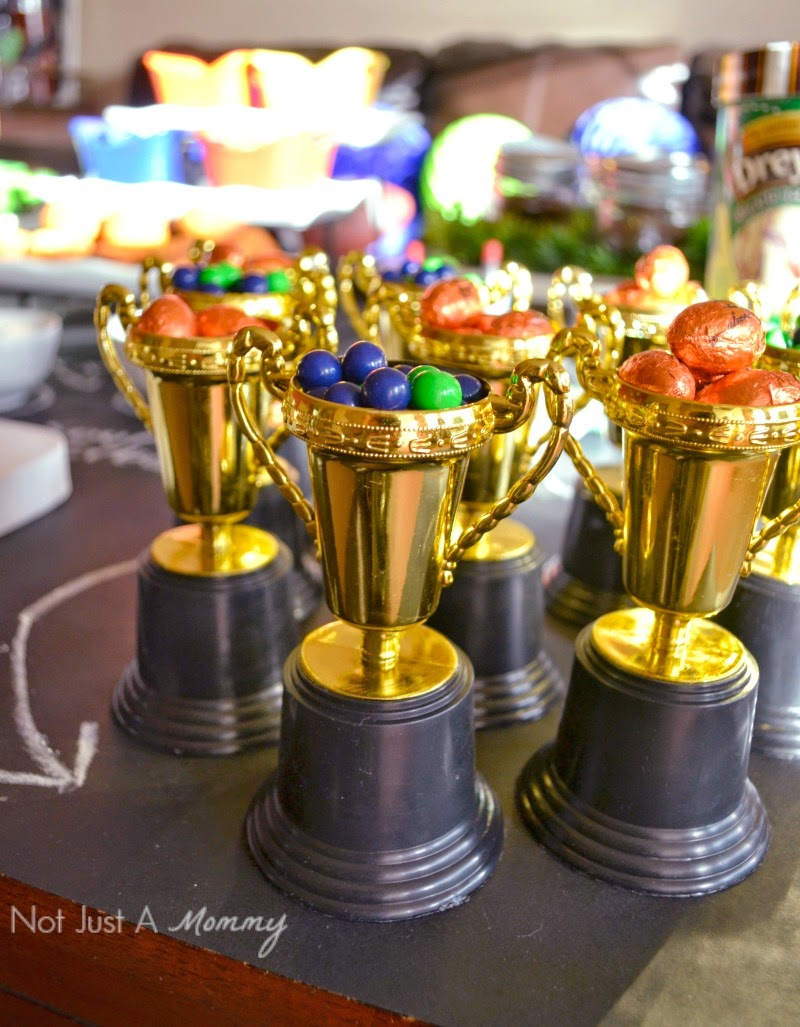 Easy Super Bowl party ideas; toy trophies as candy bowls