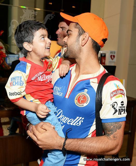 virat kohli with his sonVirat Kohli Childhood Photos